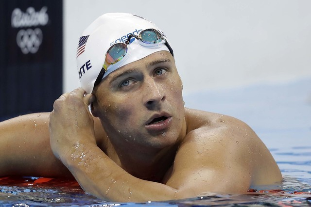 United States' Ryan Lochte checks his time in a men's 4x200-meter freestyle heat during the swimming competitions at the 2016 Summer Olympics, in Rio de Janeiro, Aug. 9, 2016. (Michael Sohn/AP)