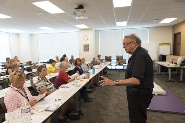 Roland Rogers teaches a self-defense class for senior citizens at Metropolitan Police Department headquarters on July 22, 2016. Jason Ogulnik/View