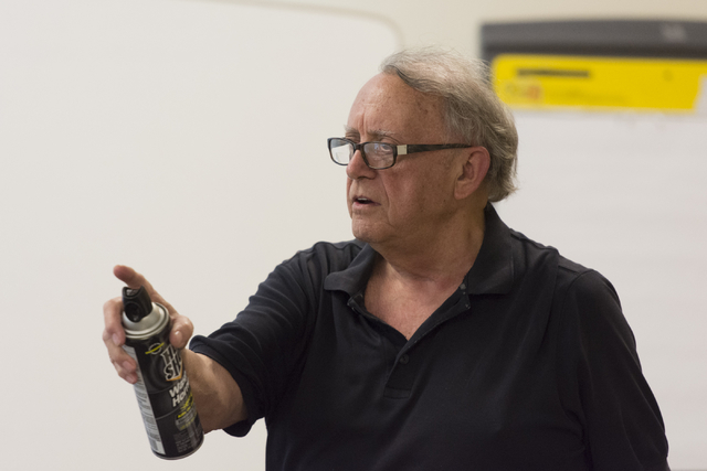 Instructor Roland Rogers discusses how wasp spray can be used for self-defense during a class for senior citizens at Metropolitan Police Department headquarters on July 22, 2016. Jason Ogulnik/View