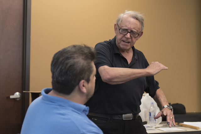 Instructor Roland Rogers, right, and volunteer, Anthony Radel, demonstrate self-defense moves during a class for senior citizens at Metropolitan Police Department headquarters on July 22, 2016. Ja ...
