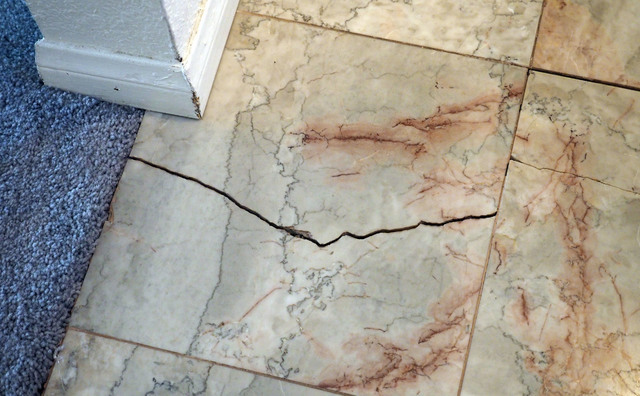 The cracks in the foundation are seen at Alexander and Elena Wilding's home in Las Vegas, Thursday, Aug. 11, 2016.  The couple blames the cracks on the construction project in front of their home. ...