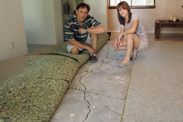 Alexander and Elena Wilding pose for a photo next to cracks in the foundation of their home in Las Vegas, Thursday, Aug. 11, 2016. The couple blames the cracks on the construction project in front ...