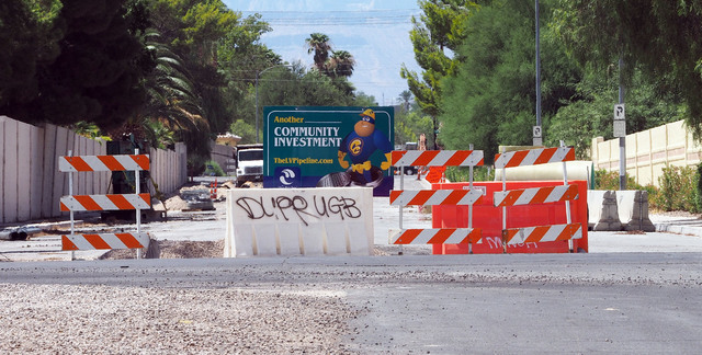 Sewer line construction takes place at Oquendo Road and Annie Oakley Drive in Las Vegas, Thursday, Aug. 11, 2016. Elena and Alexander Wilding say that the construction has damaged the foundation o ...