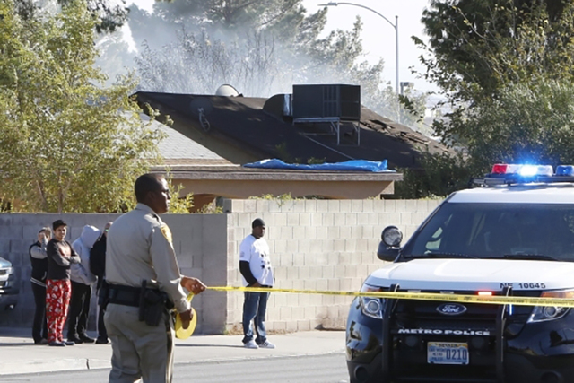 Smoke rises from the scene of a house fire where one person died and four people were in critical condition near Lamb and Sherrill Avenue, Monday, Nov. 16, 2015. Bizuayehu Tesfaye/Las Vegas Review ...