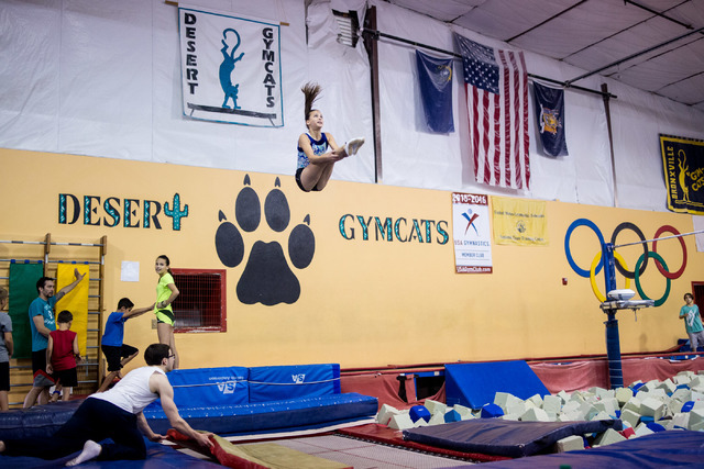 National Trampoline Champion McKenzie Baliff, 13, does her trampoline routine during practice at Desert Gymcats June 30. Elizabeth Brumley/View