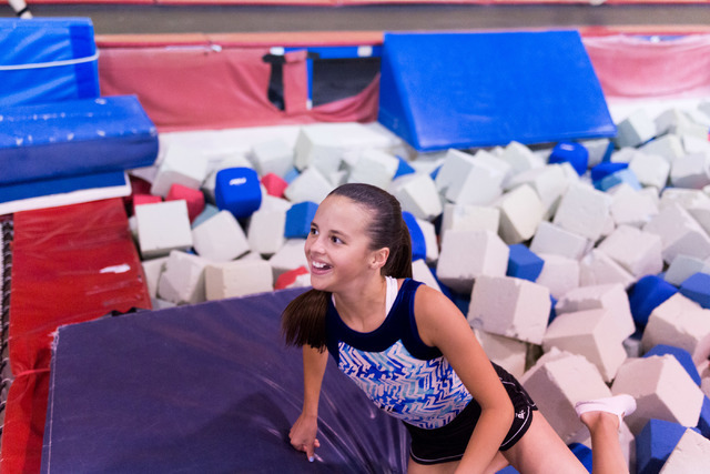 McKenzie Baliff, National Trampoline Champion, climbs out of the foam pit after completing her routine during practice at Desert Gymcats in Las Vegas June 30, 2016. Elizabeth Brumley/Las Vegas Rev ...