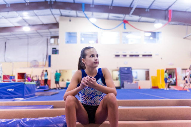 McKenzie Baliff, 13, waits her turn to practice her trampoline routine at Desert Gymcats, 950 S. Cimarron Road, June 30. Elizabeth Brumley/View