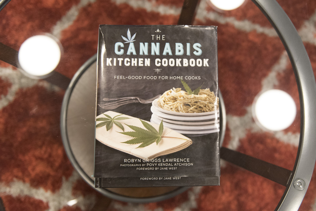 """A marijuana-themed cookbook is seen in the lobby of Las Vegas ReLeaf during a walking tour of various medical marijuana dispensaries in Las Vegas' """"Green District"""" Wednesday, Apr ..."""