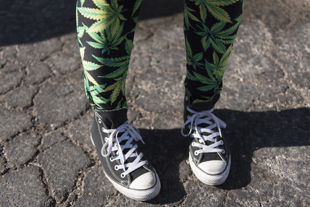 "Vicky Sprano of Green Light Productions, poses to show her marijuana-themed pants at Sahara Wellness during a walking tour of various medical marijuana dispensaries in Las Vegas' ""Green District""  ..."