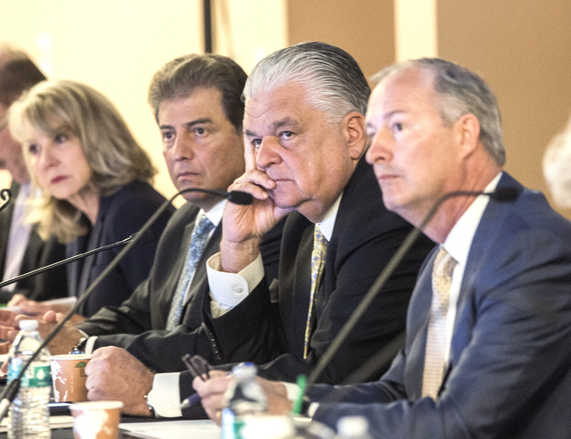 Southern Nevada Tourism Infrastructure Committee members Kristin McMillan, left, George Markantonis, Steve Sisolak and Steve Hill, listen during public comment on the proposed stadium Thursday, Au ...