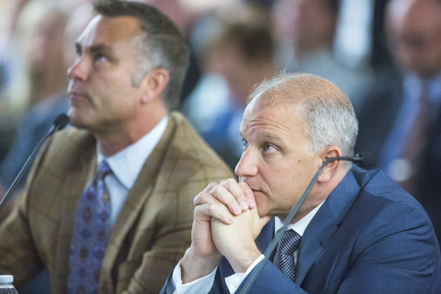 Bill Rhoda, left, president ofLegends Global Planning, and Marc Badain, Oakland Raiders president, listen during the Southern Nevada Tourism Infrastructure Committee on possible sites of the propo ...