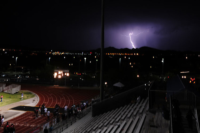 Lightning strikes in south Henderson, as seen from the Liberty High School football field after a game between Arbor View and Liberty on Friday Aug. 26, 2016. (Josh Holmberg/Las Vegas Review-Journal)