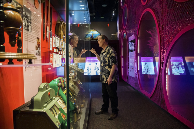 Museum director Dennis McBride looks through casino programs, letterheads and showbills from the 1950s preserved at the Nevada State Museum, Las Vegas. (Benjamin Hager/Las Vegas Review-Journal)
