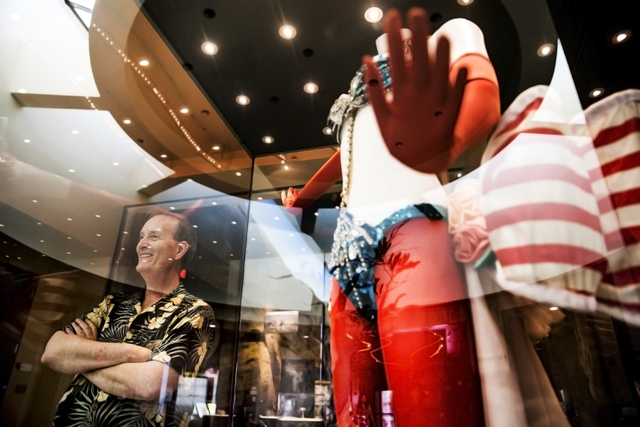 "Flanked by ""Folies Bergere"" costume display, museum director Dennis McBride surveys the lobby of the Nevada State Museum, Las Vegas. (Benjamin Hager/Las Vegas Review-Journal)"