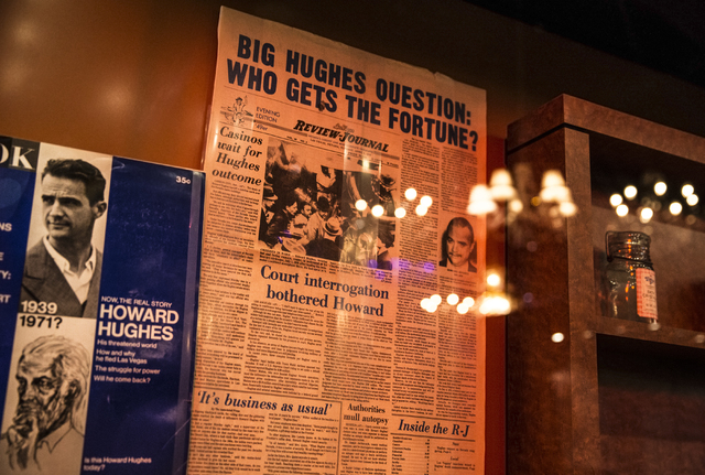 A copy of the Las Vegas Review-Journal documents the fight for Howard Hughes' fortune at the Nevada State Museum, Las Vegas. (Benjamin Hager/Las Vegas Review-Journal)