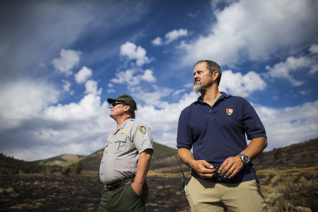 Tod Williams, chief of resources and planning at Great Basin National Park, left, and Ben Roberts, chief of natural resources at the park, survey damage from the Strawberry Fire on Thursday, Aug.  ...