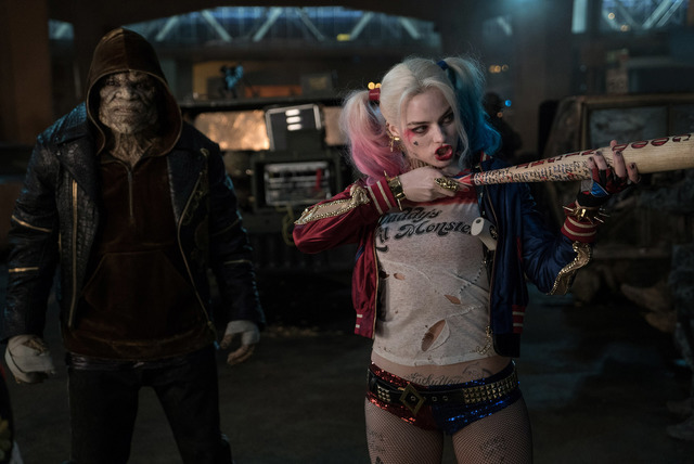"""Adewale Akinnuoye-Agbaje as Killer Croc and Margot Robbie as Harley Quinn in the action-adventure """"Suicide Squad.""""  (Clay Enos/DC Comics/Warner Bros. Pictures)"""