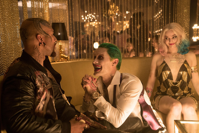 "Common as Monster T, left, Jared Leto as The Joker and Margot Robbie as Harley Quinn in the action-adventure ""Suicide Squad."" (Warner Bros. Pictures)"
