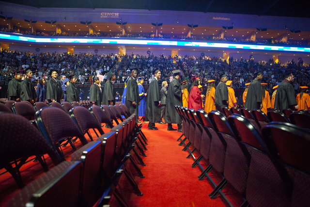 Graduates line up to take their seats during the Clark County School District's fifth annual summer graduation ceremony at the Orleans Arena in Las Vegas on Tuesday, Aug. 23, 2016. (Loren Townsley ...