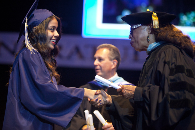 A graduate shakes School Board President Dr. Linda Young's hand during the Clark County School District's fifth annual summer graduation ceremony on Tuesday, Aug. 23, 2016, at the Orleans Arena in ...