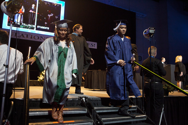 Graduates walk off the stage after receiving their diplomas during the Clark County School District's fifth annual summer graduation ceremony on Tuesday, Aug. 23, 2016, at the Orleans Arena in Las ...