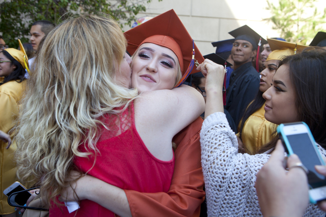 Legacy High School graduate Ashlee O'Neill hugs her mom after the graduation ceremony on Tuesday, Aug. 23, 2016, at the Orleans Arena in Las Vegas. (Loren Townsley/Las Vegas Review-Journal) Follow ...