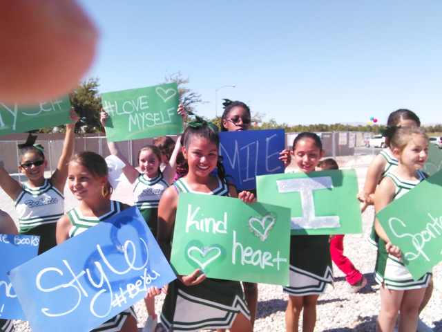 Ries Elementary School cheerleaders celebrate May 18, 2016, during the  school groundbreaking near Arville