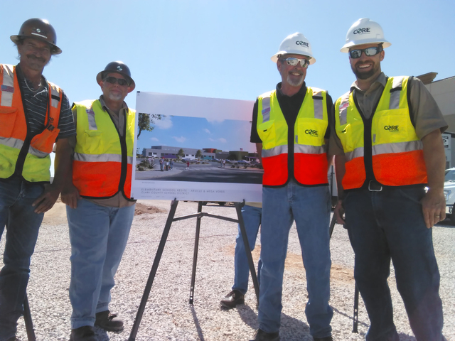 Workers pose May 18, 2016, during the school groundbreaking near Arville Street and Mesa Verde Lane. Gina Rose DiGiovanna/Special to View