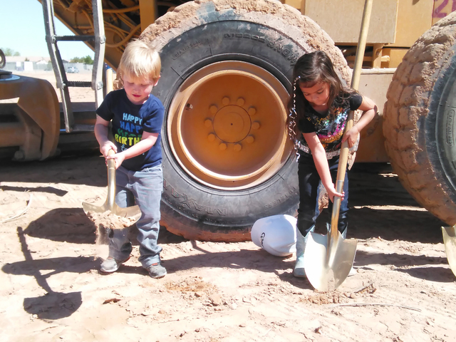 Clark County School District students, from left, Jack Staheli and Kimberly Mattingly help with the school groundbreaking near Arville Street and West Mesa Verde Lane May 18, 2016. Gina Rose DiGio ...