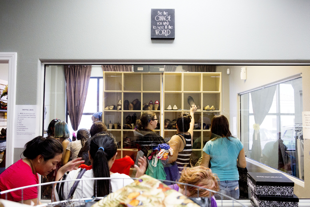 Teenagers shop in Project 150, a local non-profit, during free teen shopping day put on by the non profit Saturday, Aug. 20, 2016, in Las Vegas. (Elizabeth Page Brumley/Las Vegas Review-Journal) F ...