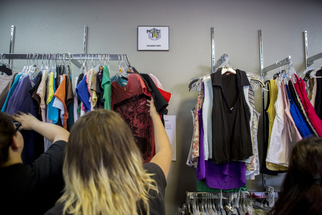 Teenagers shop in Project 150, a local non-profit, during free teen shopping day put on by the non-profit Saturday, Aug. 20, 2016, in Las Vegas. (Elizabeth Page Brumley/Las Vegas Review-Journal) F ...