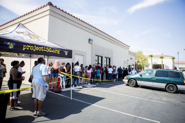 Teenagers and parents stand in line outside of Project 150, a local non-profit, during free teen shopping day put on by the non profit Saturday, Aug. 20, 2016, in Las Vegas. Elizabeth Page Brumley ...