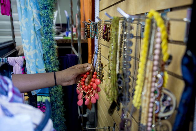 A teen girl looks at jewelry in Project 150, a local non profit, during free teen shopping day put on by the non-profit Saturday, Aug. 20, 2016, in Las Vegas. (Elizabeth Page Brumley/Las Vegas Rev ...
