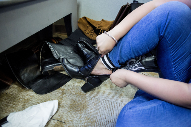 A teen girl tries on boots in Project 150, a local non profit, during free teen shopping day put on by the non-profit Saturday, Aug. 20, 2016, in Las Vegas. (Elizabeth Page Brumley/Las Vegas Revie ...