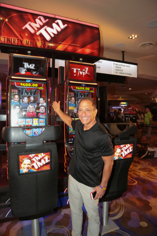 TMZ founder Harvey Levin is shown with a new TMZ slot machine at the Hard Rock Hotel on Sunday afternoon. (Courtesy)