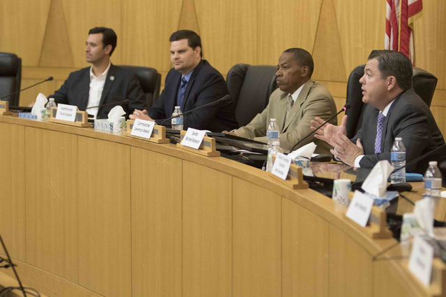 State Sen. Michael Roberson, right, speaks during a town hall meeting at the Clark County Government Center in Las Vegas, Tuesday, Aug. 9, 2016 to discuss the proposal to reorganize the Clark Coun ...