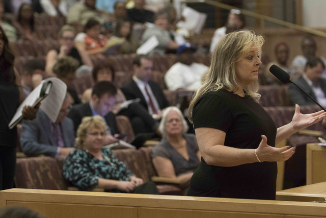 Denice Bassett, a Clark County School District support staff bus driver, discusses the proposal to reorganize the Clark County School District during a town hall meeting at the Clark County Govern ...