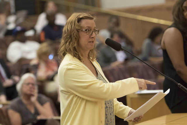 Autumn Tampa, paraprofessional director for the Education Support Employees Association, discusses the proposal to reorganize the Clark County School District during a town hall meeting at the Cla ...