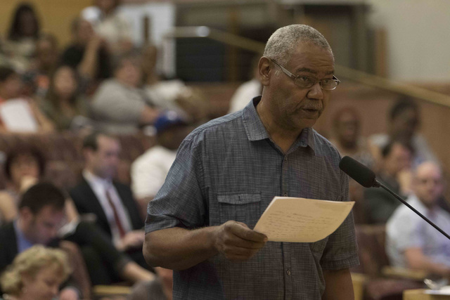 Clark County School District support staff employee James Carter discusses the proposal to reorganize the Clark County School District during a town hall meeting at the Clark County Government Cen ...