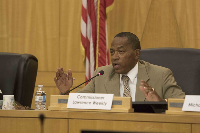 Clark County Commissioner Lawrence Weekly discusses the proposal to reorganize the Clark County School District during a town hall meeting at the Clark County Government Center in downtown Las Veg ...