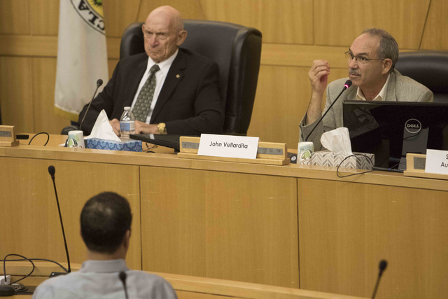 John Vellardita, right, and Mike Strembitsky, top left, are seen discussing the proposal to reorganize the Clark County School District during a town hall meeting at the Clark County Government Ce ...