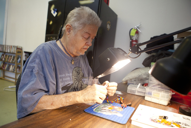 Marty Brown makes chain mail jewelry for the LGBTQ community at the transgender drop-in center in Las Vegas on Thursday, June 21, 2016. (Loren Townsley/Las Vegas Review-Journal) Follow @lorentownsley