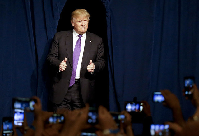 Donald Trump arrives for a caucus night rally in Las Vegas in February. (Jae C. Hong/The Associated Press)