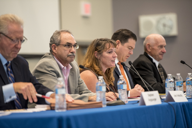 Commissioner Marilyn Kirkpatrick, center, speaks during a Clark County School District public hearing at the Northwest Career & Technical Academy in Las Vegas on Wednesday, August 3, 2016. Jos ...