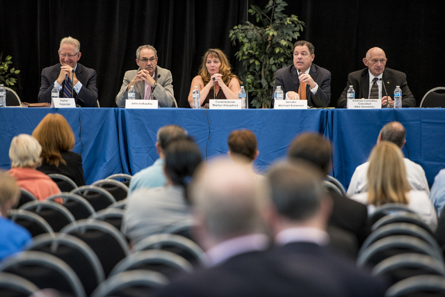 Stephen Augspurger, from left, John Vellardita, Commissioner Marilyn Kirkpatrick, Senator Micahel Roberson, and Mike Strembitsky are seen during a Clark County School District public hearing at th ...