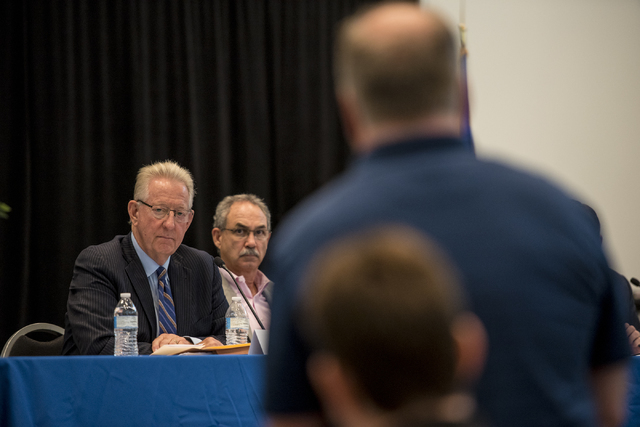 Stephen Augspurger, left, and John Vellardita are seen during a Clark County School District public hearing at the Northwest Career & Technical Academy in Las Vegas on Wednesday, August 3, 201 ...
