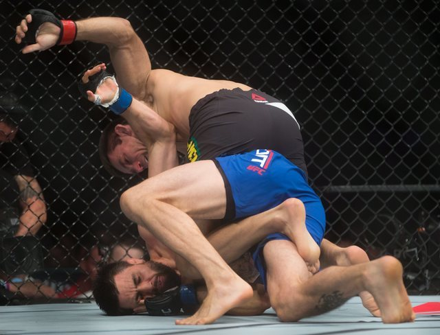 Demian Maia, top, of Brazil, and Carlos Condit, of Albuquerque, fight during a welterweight bout during a UFC Fight Night event in Vancouver, British Columbia on Saturday, Aug. 27, 2016. (Darryl D ...