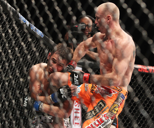 Donald Cerrone lands a combination to the body and head of Myles Jury during their fight at UFC 182 Saturday, Jan. 3, 2015 at the MGM Grand Garden Arena.Cerrone won a unanimous decision. (Sam Morr ...