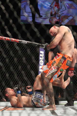 Donald Cerrone lands a kick to the leg of Myles Jury during their fight at UFC 182 Saturday, Jan. 3, 2015 at the MGM Grand Garden Arena.Cerrone won a unanimous decision. (Sam Morris/Las Vegas Revi ...
