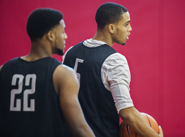UNLV sophomore guard Jalen Poyser, right, warms up before practice at the Mendenhall Center at UNLV on Monday, August 1, 2016, in Las Vegas. (Benjamin Hager/Las Vegas Review-Journal)